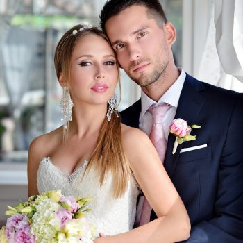Wedding couple indoors is hugging each other. Beautiful model gi